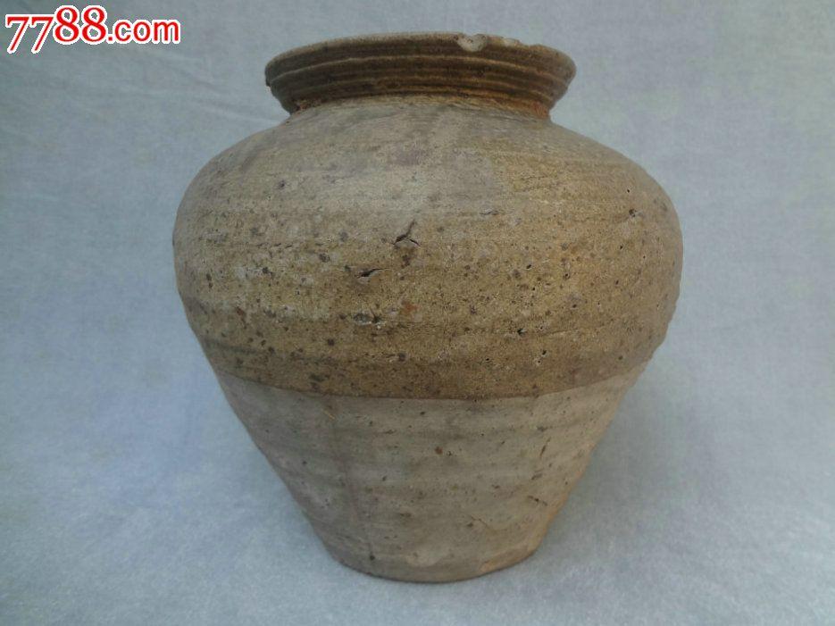很老的粗��_一款很老的青釉陶瓷罐,束口圆肚瘦足,表面粗旷豪放,器