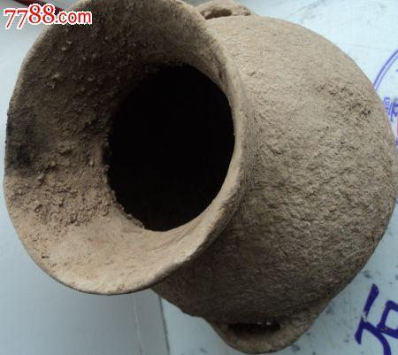 土黄色黑色花纹的陶罐