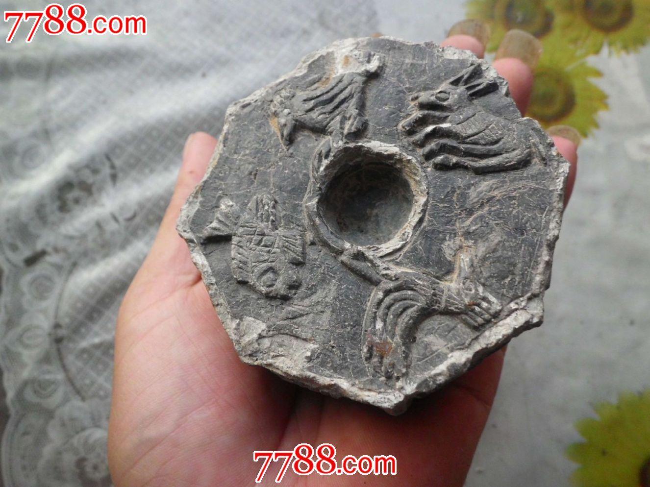 一个浮雕八边形动物花卉泥塑烧制麻砣